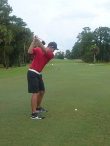 Chris Miller swinging golf club